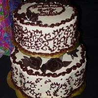 Scrollwork Cake  Large chocolate mocha cake with chocolate mocha mousse filling. Small white chocolate cake with white chocolate raspberry filling. SMBC w/...