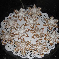 Gingerbread Snowflakes  My first attempt at snowflakes. Martha Stewart gingerbread recipe. Royal icing using liquid pasteurized whites. Nonpareil pearls. Dusted...