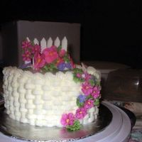 Basketweave Buttercream basketweave with Royal Icing flowers & color flow fence