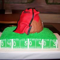 Ocoee Bulldogs Pop Warner 9 X 13 sheet cake frosted in buttercream. 8 Cup measuring cup covered in fondant to look like a football and jersey out of fondant/gumpaste...