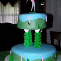 Girl Golfer My daughter wanted a golf party for her birthday. So I constructed a golf cake for a 7 year old girl, including painting the shirt on the...