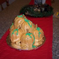 Pile O'pumpkins This is a spice cake made into mini bunt cakes that are sanwiched together with cream cheese frosting and stacked on top of one another and...