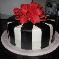 Black Stripes With Bow   Cake is iced in buttercream with black fondant stripes. The bow is gumpaste