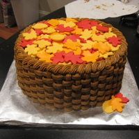 Basket Of Leaves Pumpkin spice cake with cream cheese frosting and fondant leaves.