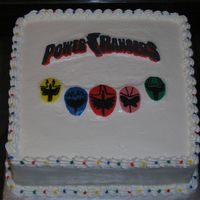 Power Rangers Did this cake last minute for my neighbor. Not very happy with the outcome. WASC with buttercream icing and FBCT.