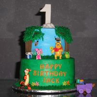 Winnie The Pooh This cake was for a friend's son who was turning one. I got the idea for this cake off this site. WASC cake with bavarian cream...