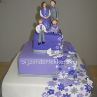 Purple Wedding the couple already had two children ans wanted them to be on the cake.statue hand molded out of marsefond.