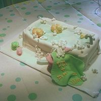 Baby Bath And Bubbles   Bathtub is yellow cake frosted with buttercreme and covered in Fondant. Towel, stool, soap, duckies and bubbles are also Fondant.