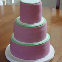 Fushia And Green Wedding Cake My very first paid cake! This was a small display wedding cake atop a cupcake stand. I had so many problems with this cake! Thank goodness...