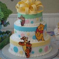 Winnie The Pooh Baby Shower Winnie the pooh baby shower cake. First attempt at the fondant/gumpaste loop bow and I made the characters out of royal icing. Inspiration...