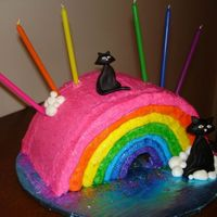 Jessie Rose's Rainbow (With Kitties, Of Course)  What started out as a purse cake turned into a rainbow when my daughter informed me that rainbows are way better than purses. (huh...I...