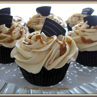 Chocolate Caramel Cupcakes  Chocolate Cupcakes injected with Dulce de Leche, then topped with a Caramel Swiss Meringue Buttercream, drizzled with caramel and topped...