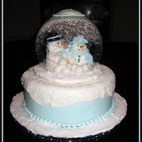 Snowglobe  Chocolate cake with peppermint buttercream filling, chocolate ganache, then fondant. Topper is made from fondant/gumpaste and the ball is...