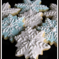 Snowflakes NFSC with fondant and royal icing. I do these every year in blue fondant with white icing, but this year tried the white on white and I...