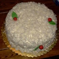 Christmas Coconut Cake  My very first coconut cake...I made it as sort of a peace offering for some warring family members. They loved it! I used a box mix, since...