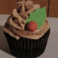 Christmas Cupcake!   Chocolate with chocolate ganache filling, chocolate buttercream. Gumpaste holly berry and leaf.