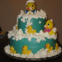 My Fir=St Tier Cake!  This is devils food with BC. The larger bubbles are made with fondant and the two large duckies are store bought rubber duckies. I know...