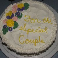 Thank You/ Anniversary Cake  First yellow cake from scratch, BC icing with royal icing flowersFriend requested swirly top, first cake not using a smooth surface. I had...