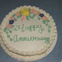 Anniversary Cake  I made this for a good friend,she loved it! Yellow cake with BC frosting and RI flowers. I need to practice on my writing and I just...
