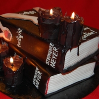 Twilight/new Moon Books W/edible Candles  The 1st 2 in the Twilight Saga. The books are red velvet cake with cream cheese frosting and the candles are red velvet cake wrapped with...