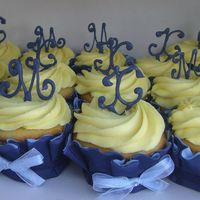 Bridal Cupcakes   Cupcakes for a friends bridal shower with her and her fiance's initials in blue candy melts on top.