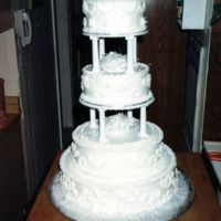 3_Tier_R.jpg I made this for my cousin's son. White cake. White crisco frosting and RI primroses