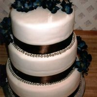 Hydrangea Wedding Cake  This was for a very nice couple. It is double chocolate fudge with a whipped chocolate ganache filling covered in fondant. I loved the...