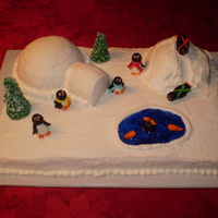 Penquin Vanilla cake and vanilla b/c icing with fondant penquins.Igloo is fondant covered and snow mound is b/c. Trees were ice cream cones coverd...