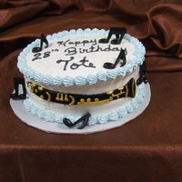 Clarinet Musical instrument made out of fondant and painted with food coloring.