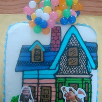 Up This is an 8 inch square cake othe the house drawn and colored in buttercream. the balloons and stickers were added.