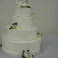 My Sister's Wedding Cake   White almond sour cream cake with buttercream filling and icing. Gumpaste flowers on top.