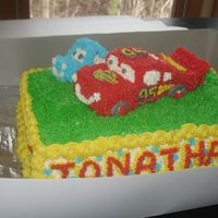 Cars Cake Picture 1 Of 3 I made this cake using this website for direction. Sally and McQueen were made by carving yellow cake made from loaf pan. I used aluminum...