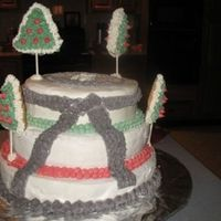 Karate School Christmas Cake I made this cake for my husband's karate class party. The school emblem was transfered on the top using piping gel. I added christmas...