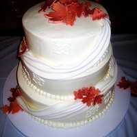 "Autumn Elegance 9""-11""-13"" French Vanilla w/ buttercreamswags and leaves are gumpaste"