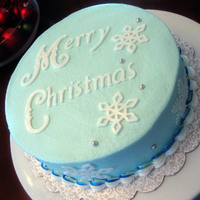 "Snowy Christmas 8"" chocolate cake w/ raspberry filling and vanilla buttercreamFondant accents made with Cricut"