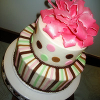"Pink Shimmer 6"" and 9"" white chocolate cake w/ raspberry cream fillingalmond butercreamFondant accents and bow"