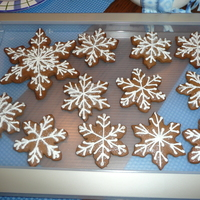 Gingerbread Snowflake Cookies With all the snow we are having I just had to make gingerbread snowflake cookies with royal icing and sugar glitter. Thanks for looking...