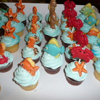 Under The Sea Cupcakes yellow cupcakes and chocolate cupcakes with buttercream frosting and chocolate under the sea creatures. thanks for looking