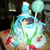 "Under The Sea Cake 7 "" yellow cake with buttercream frosting and gum paste and fondant sea creatures / chocolate bucket and sucker"