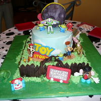 Toy Story / Farm Animal Cake My granddaughter wanted a Toy Story / farm cake so this is what I came up with. thanks to all of you at CC for ideas. bottom cake is 14x14...