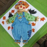 Scarecrow Used a large sheet cake pan and carved out design for body. Use half ball pan for head. The crows are made with rice crispy treats. All was...