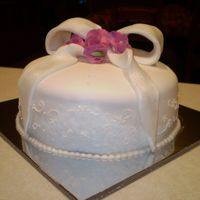 Birthday Cake With Bow And Sweet Peas sweet peas made from flower paste, and bow from fondant dusted with luster
