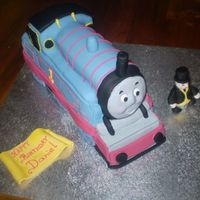 Thomas The Tank Engine & Sir Topman Hat ( Still The Fat Controller To Me ) Chocolate mudcake, a lot of hours work put into this cake I have learnt a lot from this cake, and know where i went wrong, I also learnt i...