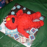 Elmo On A Pillow I made this cake for my sons second birthday, white mud cake body, chocolate mud cake for his arms and legs, butter cake for his head, the...