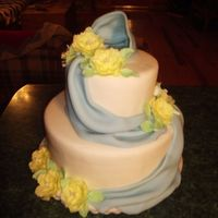 "Ribbons And Posies Fondant covered, two tier cake. 6 & 10"" layer cakes.Fondant drapes and gum paste Posies."