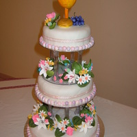 First Holy Communion Cake FRUIT CAKE DECORATED IN ROLLED FONDANT ICING WITH FLOWERS AND TOPPER IN GUM PASTE.