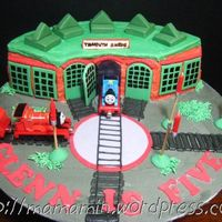 Tidmouth Sheds Tidmouth Sheds for Thomas and his friends. Decorated with BC and fondant accents. Trains are die-cast toys.