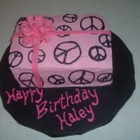 Peace Birthday Pink wrapping paper with black peace signs. Fondant bow.