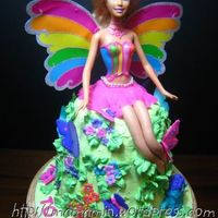 Barbie Fairytopia For a little girl who is crazy about Barbie Fairytopia. Cake decorated with BC. Butterflies are royal icing. Flowers are fondant