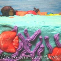 Snorkelling In The Tropical Sea Part of the cake which depicts a couple of swimmers snorkelling in the tropical sea. I don't know how to make a montage of photos!...